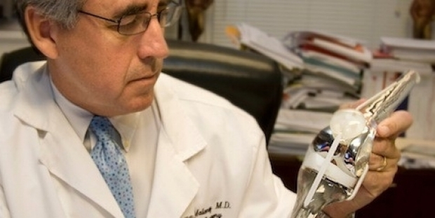 Photo of Dr. Maloney with an artificial joint